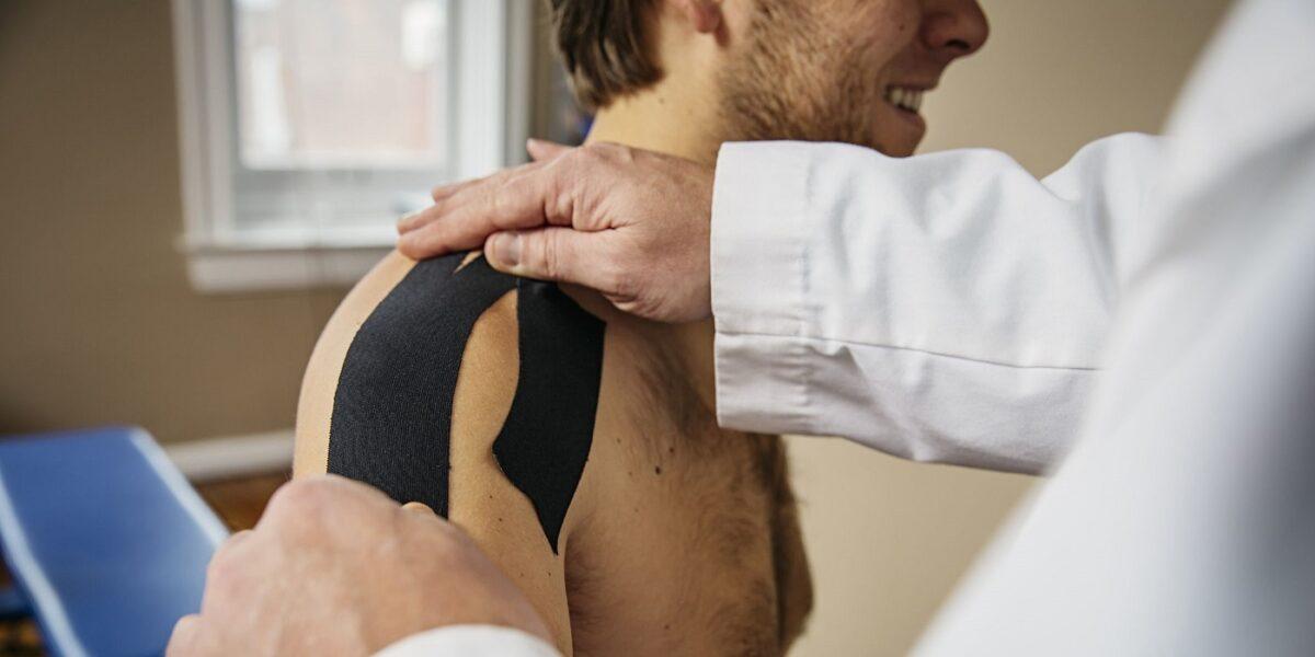 Texas orthopedic sports medicine Doctor applying shoulder tape